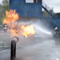 Firefighters extinguishing pipeline fire from accident
