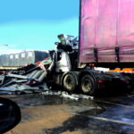 Truck trailer pickup accident with car on highway